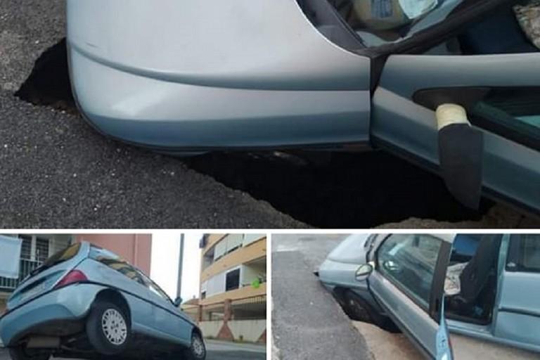 Bisceglie, l'auto incastrata nella voragine creatasi