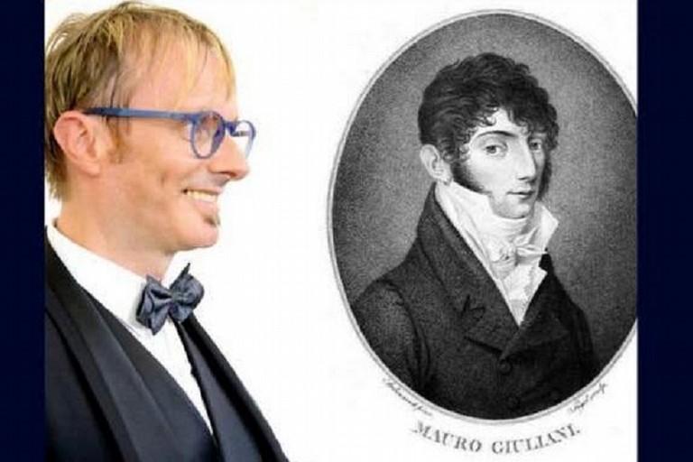Nicola Giuliani a fianco di un ritratto del suo avo Mauro, chitarrista di fama internazionale